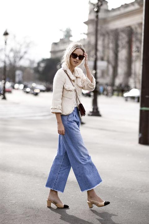 Para elevar el nivel de un culotte vaquero,The Fashion Guitar lo acompaña desus slingbacks de Chanel y unaelegante chaqueta de tweed.